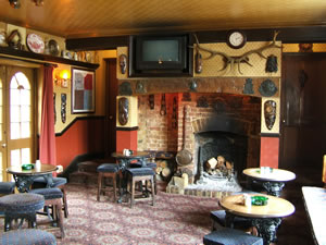 Top bar at Prince of Wales Pub Weybridge Surrey - Fireplace has roaring log fire in winter