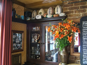 Sporting memorabilia and flowers at The Prince of Wales Pub Weybridge Surrey
